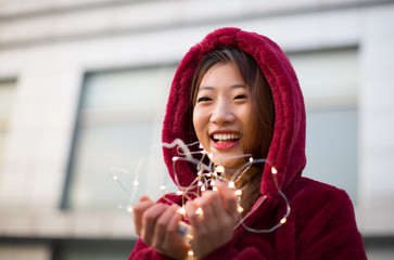 Portrait of a Girl Holding Lights and Having a Big Nice Smile