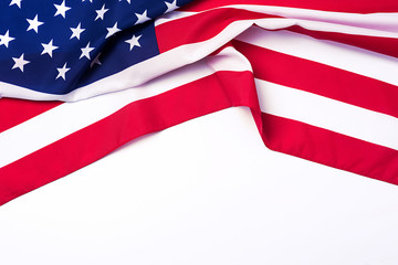 Closeup of American flag on white background.
