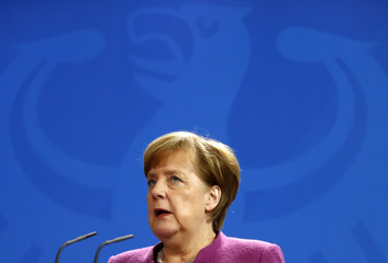 German Chancellor Angela Merkel addresses a news conference after talkswith Swedish Prime Minister Stefan Lofven at the chancellery in Berlin