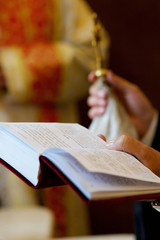 The Christian priest holding a Bible