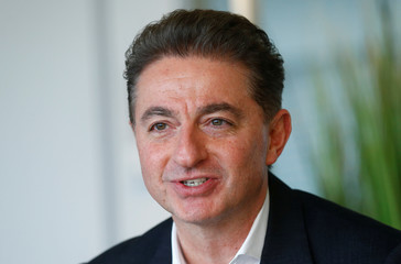 CEO of Deutsche Telekom's T-Systems, Al-Saleh speaks during an interview with Reuters in Frankfurt