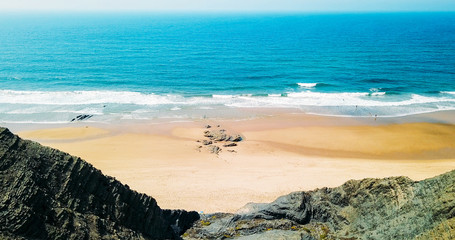 Aerial Panoramic Drone View Of Blue Ocean Waves And Beautiful Sandy Beach in Portugal
