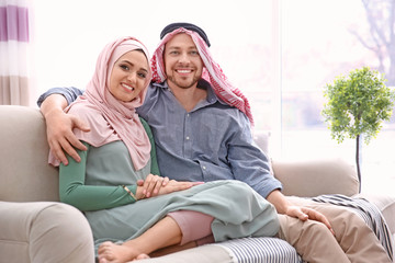 Happy Muslim couple at home