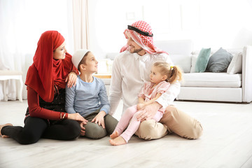 Happy Muslim family at home
