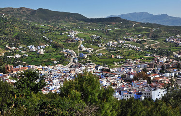 View of Chefchaouen with winding paths into the valley.
