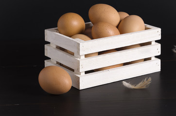 Fresh farm eggs on a black background