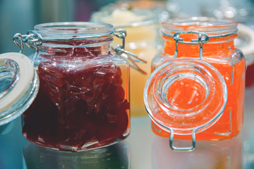 glass jars of jelly on display