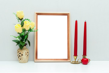 A4 wooden frame mockup with flowers and red candles