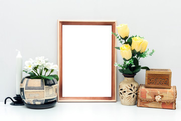 A4 wooden frame mockup with flowers and boxes