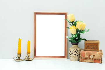 A4 wooden frame mockup with yellow flowers and boxes
