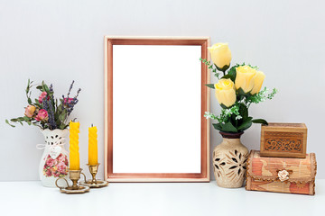 A4 wooden frame mockup with yellow flowers, candles and boxes