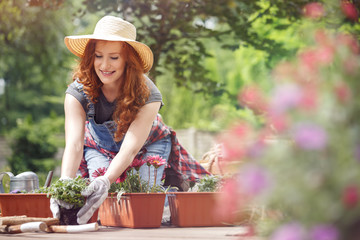 Girl relaxes during gardening work