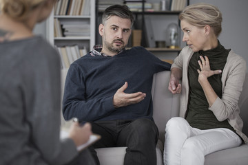 Quarreling couple with therapist