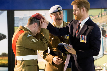 Britain's Prince Harry presents one of the latest graduates with their Wings at the Army Aviation Centre in Middle Wallop