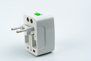 Universal plug adapters for travel around the world isolated on white background.