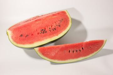 Watermelon and sliced of watermelon on white background.