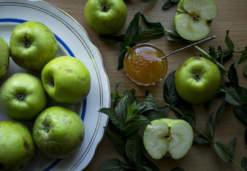 photo of green apples with yellow honey and mint