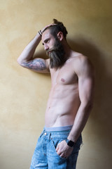 young bearded man bare chested looking sideway