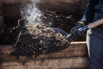 Hot steam while turning compost bin.