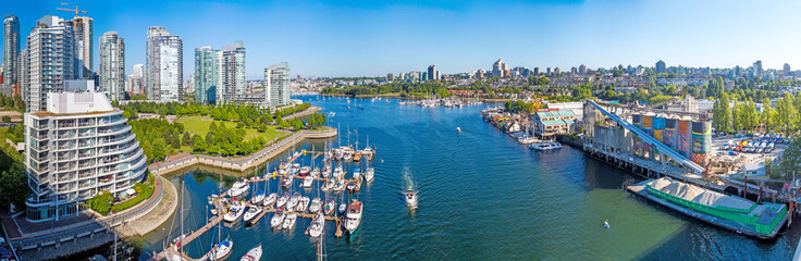 False Creek, Vancouver Canada, yacht mooring and sunny modern city downtown, all on one wide panoramic picture