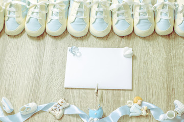 Baby booties for newborn boy shower party, store add or post card. Top view. Copy space. Framing