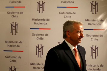 Chile's Finance Minister Larrain leaves after a news conference at the Finance Ministry building in Santiago