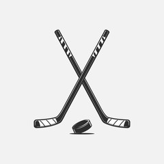 Crossed hockey sticks and puck vector illustration