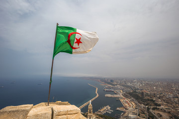 Oran - June 03, 2017: The Algerian flag overlooking the city of Oran, Algeria