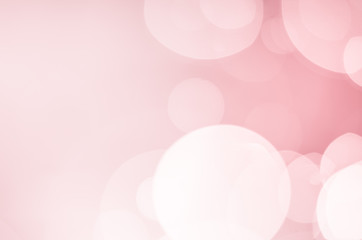 White bokeh on pink background