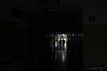 People walk in the corridors of the Central Hospital of San Cristobal during a blackout in San Cristobal