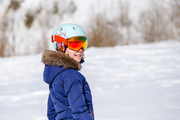 Portrait of athlete in helmet at winter day on blurred background