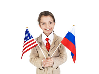 A cute boy holds the flags of Russia and the USA in his hands. Isolated. White background.