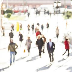 Urban background people moving- abstract blur