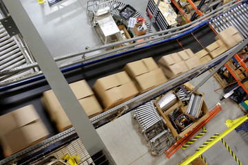Boxes of toys move on a conveyor belt in the Toys 'R' Us vendor Learning Resources warehouse in Vernon Hills