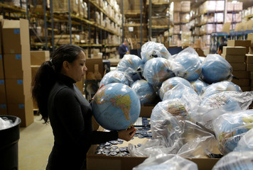Toys 'R' Us vendor Learning Resources worker assembles a globe at the warehouse in Vernon Hills
