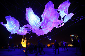 People walk next to a light installation during the Festival of Lights in Zagreb