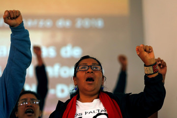 Relative of one of the 43 students of Ayotzinapa shouts slogans during a news conference in Mexico City