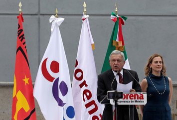 Leftist front-runner Andres Manuel Lopez Obrador, accompanied by his wife Beatriz Gutierrez Mueller, addresses his supporters after being registered as a presidential candidate of MORENA in Mexico City