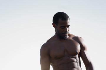 Portrait of african black sportsman on topless