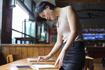 Asian businesswoman working in cafe