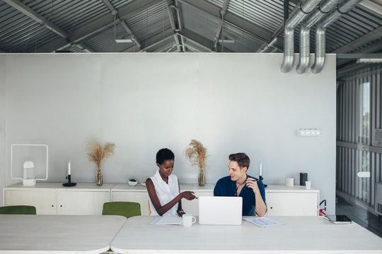 Man and woman collaborating
