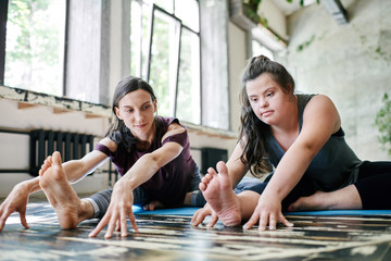 Girl with Down syndrome demonstrating flexibility