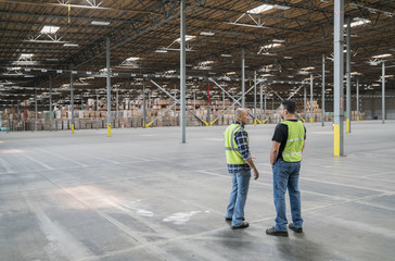 Warehouse workers in storage facilty
