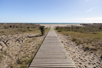 Wooden boardwalk to beach of Castelldefels, province Barcelona,Catalonia.