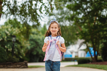 Portrait of a cute young girl wearing a backpack