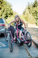 Disabled Active Woman Moving From Wheelchair to Bicycle