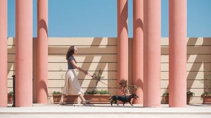 Stylish Woman Walking With The Dog