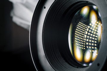Photo Camera or Video lens close-up on black background, objective, concept of photographer camera man job, looking for a photographer, journalist, a videographer to work