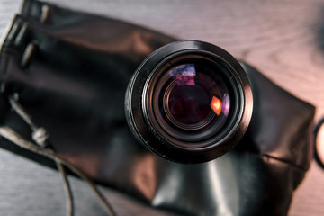 Close-up shot of photo lens on a table.camera accessories, photographer concept design