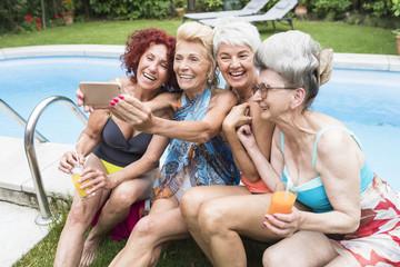 Group of active senior women takinga selfie with the phone